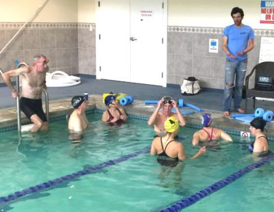 Coach Justin Torrellas prepares swimmers for triathlon events.